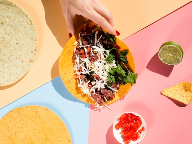 Arrangement of delicious taco bread and ingredients Free Photo
