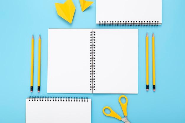 Arrangement of desk elements on blue background Free Photo