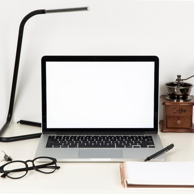 Arrangement of desk elements with empty laptop screen Free Photo