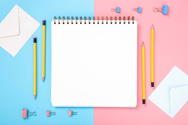 Arrangement of desk elements with empty notebook Free Photo