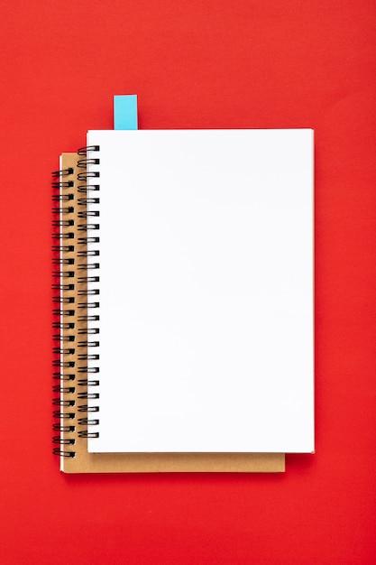 Arrangement of desk elements with empty notebooks Free Photo