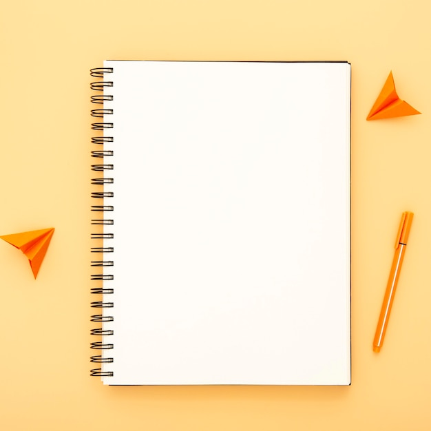 Arrangement of desk elements on yellow background Free Photo