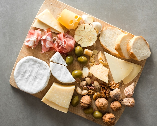 Arrangement of different delicacies on wooden board Free Photo