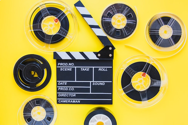 Arrangement of film reels and clapboard Free Photo