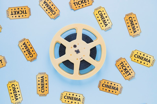 Arrangement of filmstrip and tickets Free Photo