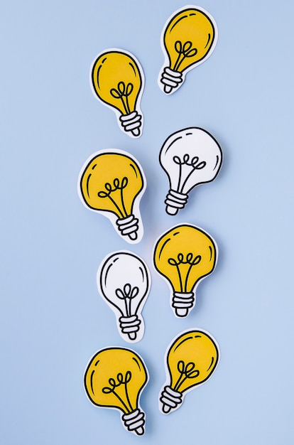 Arrangement of golden and silver light bulbs top view Free Photo