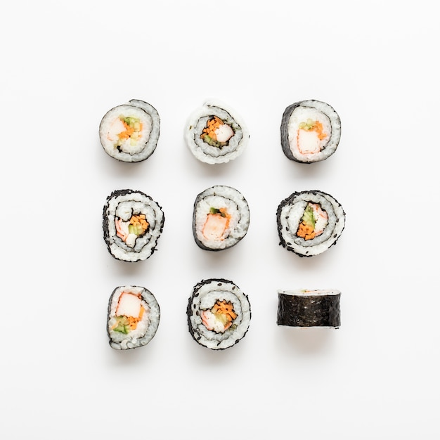 Arrangement of maki sushi rolls Free Photo
