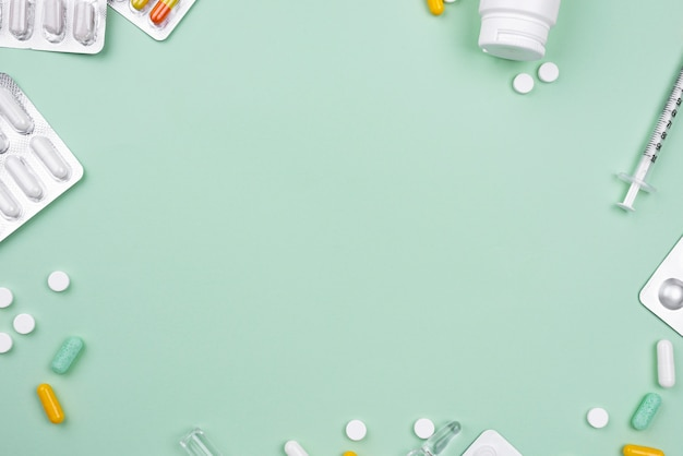 Arrangement of medical objects on green background with copy space Free Photo