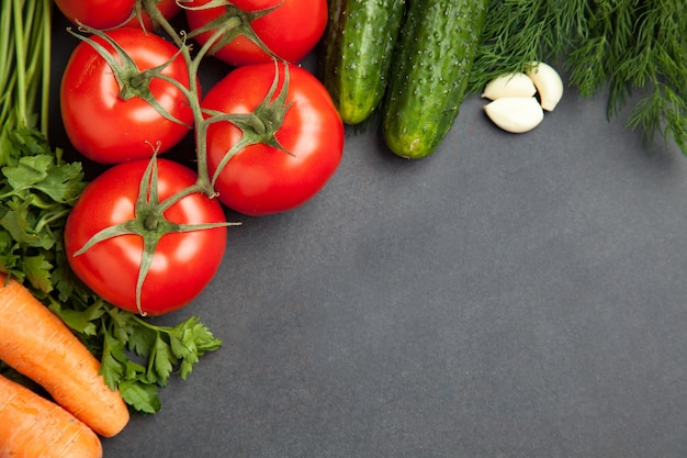 Arrangement of mixed colorful vegetables, isolated on dark gray slate stone background with empty copy space. banner Premium Photo