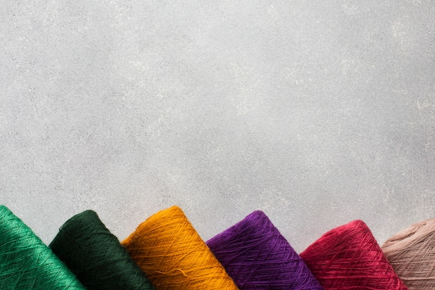 Arrangement of multicoloured sewing threads Premium Photo
