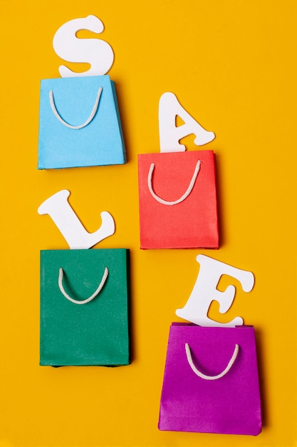 Arrangement of paper bags and letters Free Photo