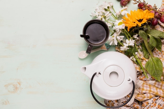 Arrangement of tea-party and flowers Free Photo