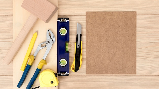 Arrangement of tools for carpentry on desk copy space Free Photo