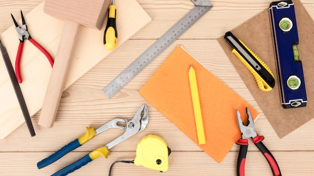 Arrangement of tools for carpentry on desk Free Photo