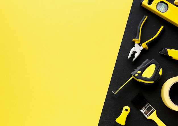 Arrangement of tools with yellow copy space background Free Photo