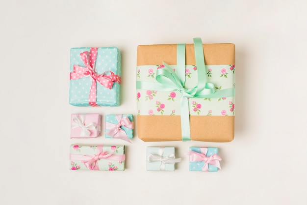 Arrangement of various wrapped gift boxes against white backdrop Free Photo