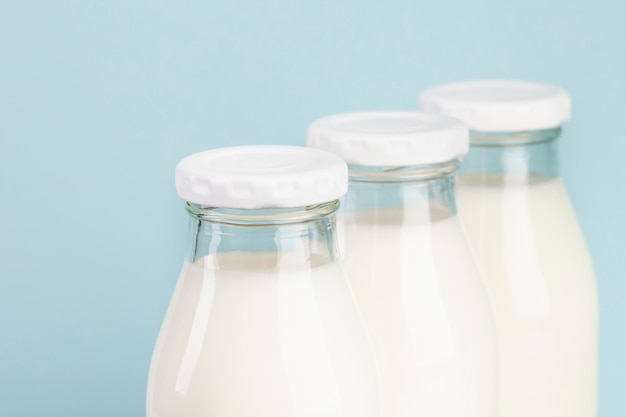 Arrangement with bottles filled with milk Free Photo