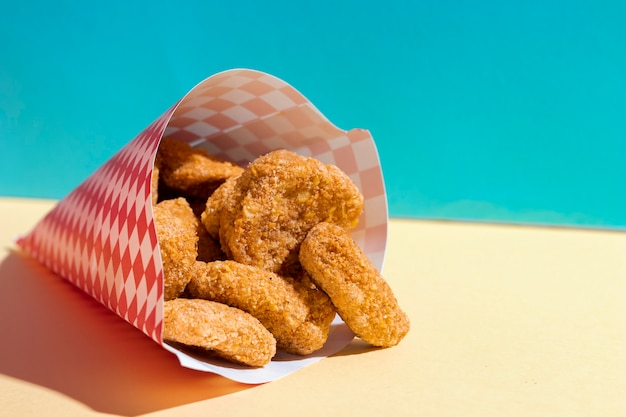 Arrangement with chicken nuggets in wrapping Free Photo