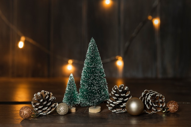 Arrangement with christmas trees and lights Free Photo