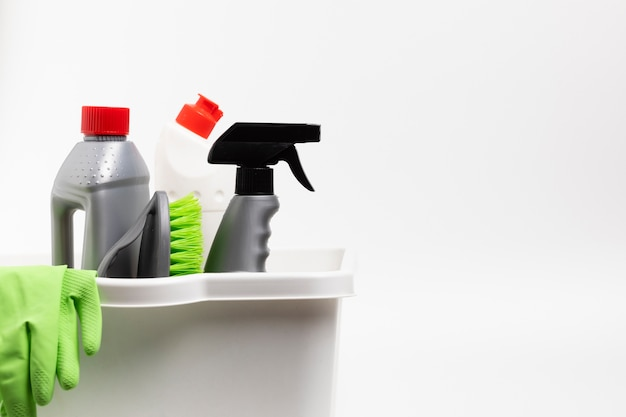 Arrangement with cleaning products and gloves in basin Free Photo