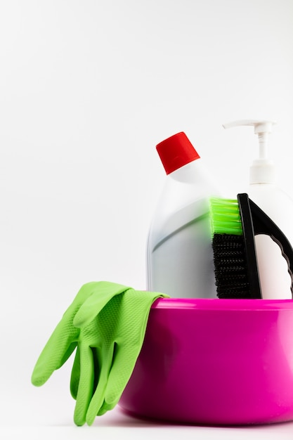 Arrangement with cleaning products in pink basin Free Photo