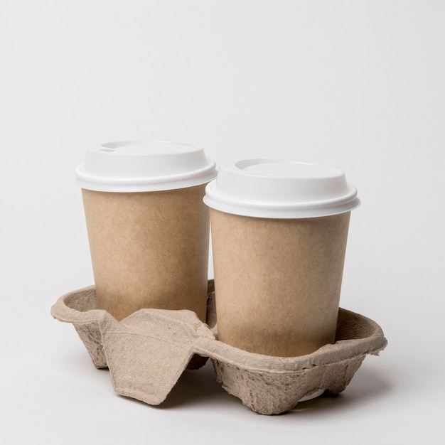 Arrangement with coffee cups in cup holder Free Photo