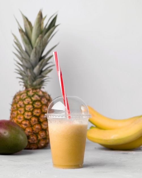 Arrangement with cup of smoothie Free Photo