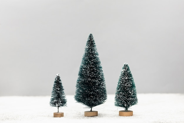 Arrangement with cute little christmas trees Free Photo