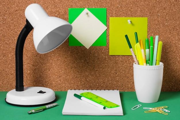 Arrangement with desk lamp and notebook Premium Photo