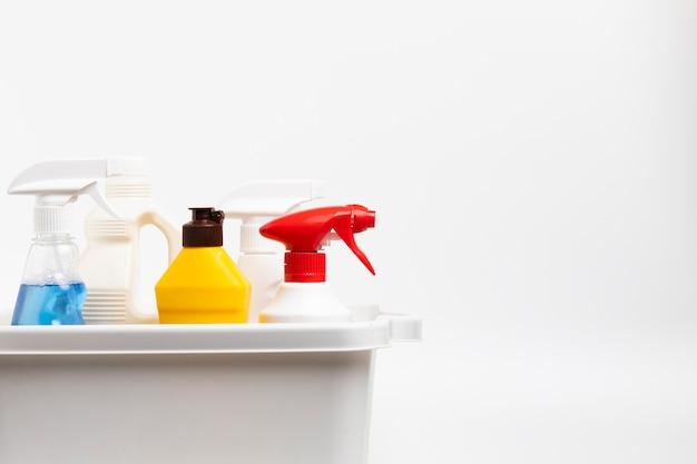 Arrangement with detergent bottles in basin Free Photo