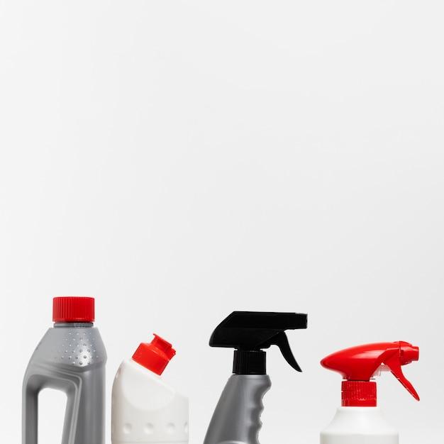 Arrangement with detergent and spray bottles Free Photo