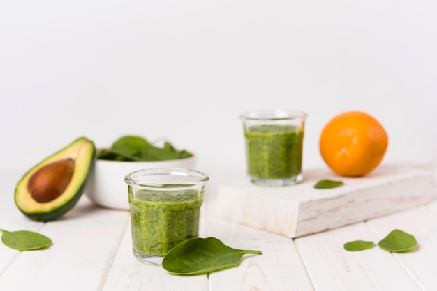 Arrangement with healthy green smoothies Free Photo