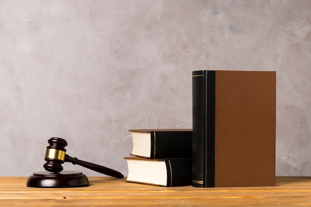 Arrangement with judge gavel, striking block and books Free Photo