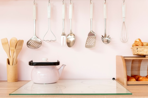 Arrangement with kitchen utensils and teapot Free Photo