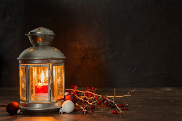 Arrangement with old lamp and twigs Free Photo