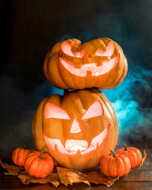 Arrangement with spooky carved pumpkins Free Photo