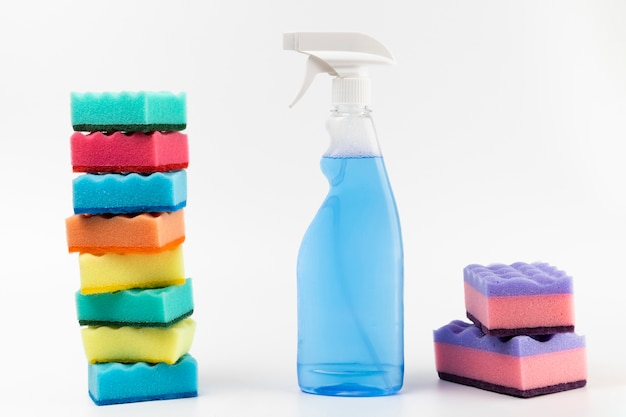 Arrangement with spray bottle and colourful sponges Free Photo