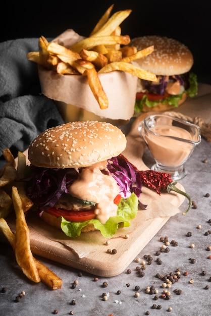 Arrangement with tasty hamburger and fries Premium Photo