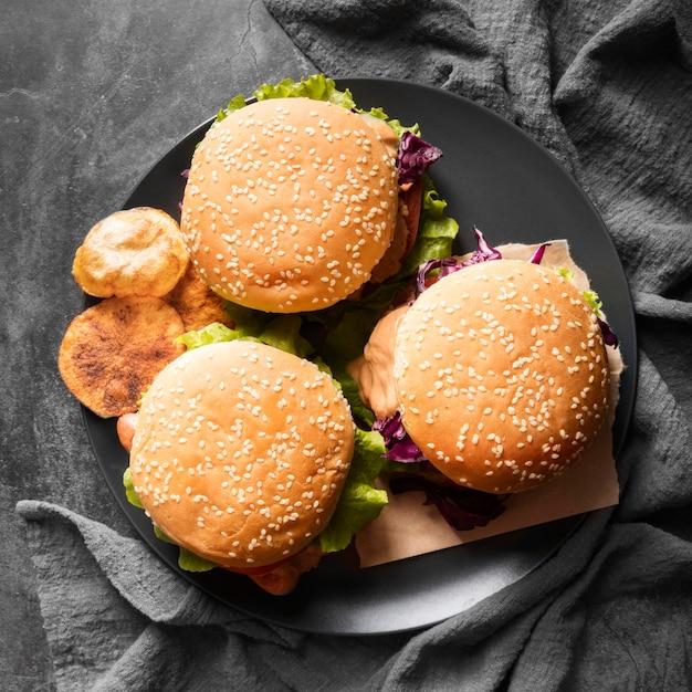 Arrangement with tasty hamburgers Free Photo