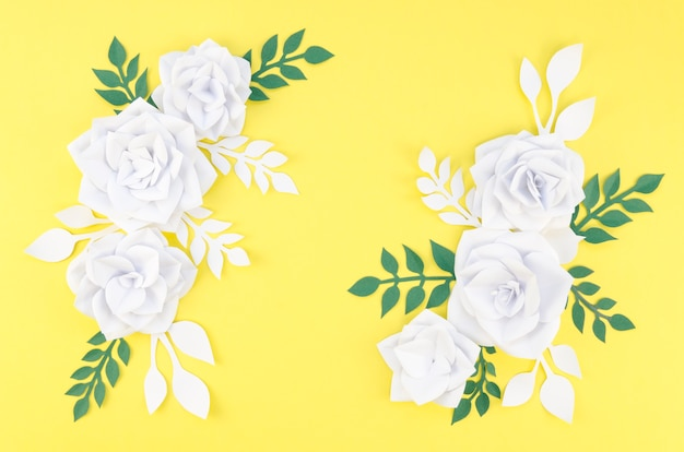 Arrangement with white flowers and yellow background Free Photo