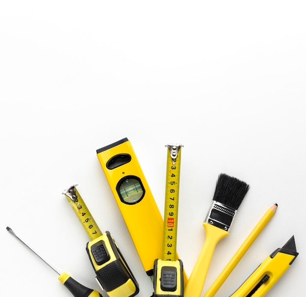 Arrangement of yellow tools with copy space Free Photo
