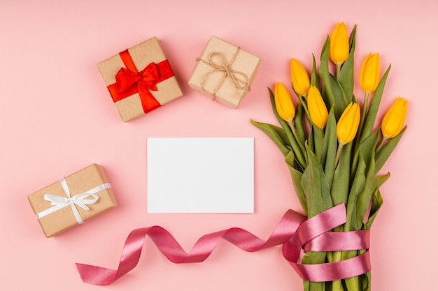 Arrangement of yellow tulips with empty card Free Photo