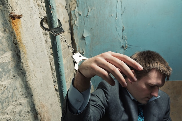 Arrested man with handcuffed hand Premium Photo