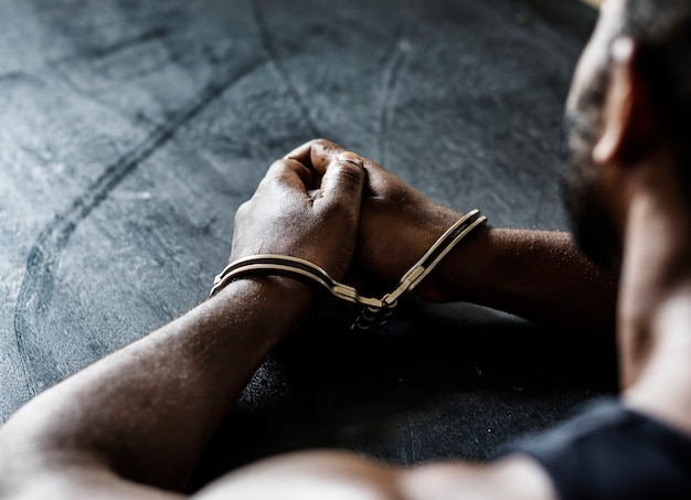 Arrested man with handcuffs on wrists