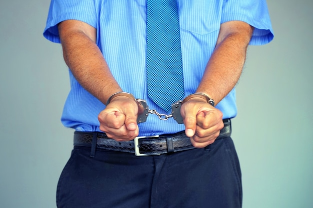 Arrested man with handcuffs Premium Photo