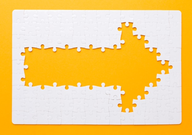 Arrow made of puzzle pieces pointing right Premium Photo