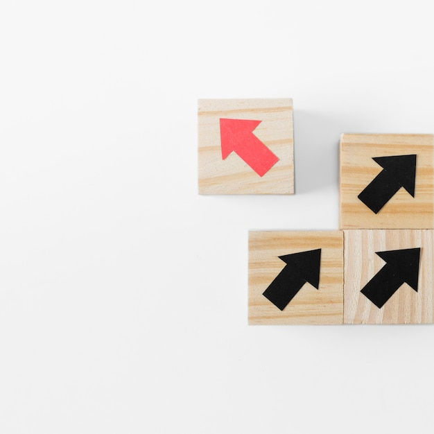Arrows on wooden cubes and copy space Free Photo