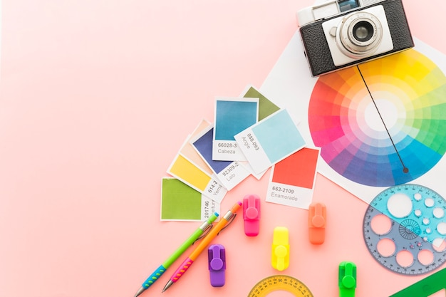 Art concept with camera and paint materials Free Photo