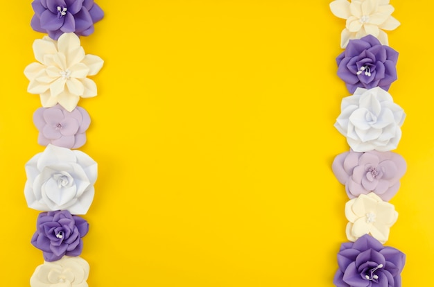 Art concept with floral frame and yellow background Free Photo