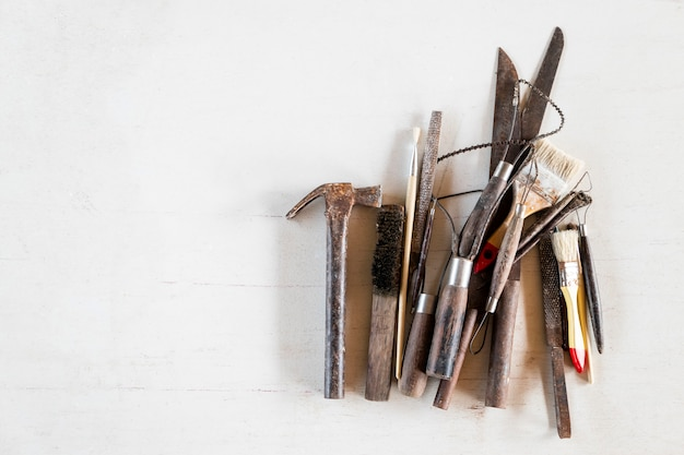 Art and craft tools on a white background. Premium Photo